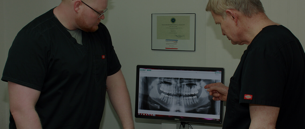 Odessa dentists, Dr. Stephen and Franklin Boyles examining dental x-rays