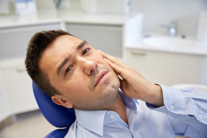 Man experiencing dental pain.